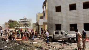 The bombing in Aden, claimed by Islamic State, killed more than 50 pro-government troops preparing to fight Houthi rebels in Yemen's north.