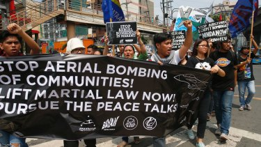 Protesters call for an end to bombing in Marawi during a rally in Manila.