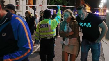Members of the public are led away from the scene near London Bridge after the attack.