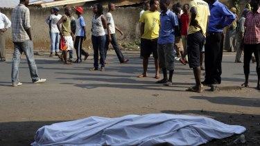 The body of a man lies on a street in Bujumbura as polls open.