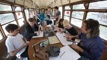 Fitzroy High School teachers Penelope stray and Michael Meneghetti  working with students in their classroom, an old w class tram.