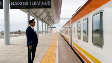 A Kenya Railways employee sends off the train from Nairobi to Mombasa at the new Standard Gauge Railway terminal in Nairobi.