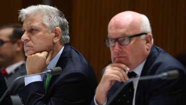 Attorney-General's Department secretary Chris Moraitis (left) with his minister, George Brandis, in Senate estimates in February.