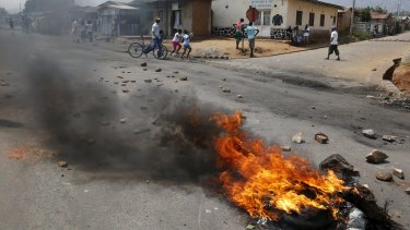Unrest: A barricade burns on a rock strewn street in Bujumbura's Niyakabiga district on election day.