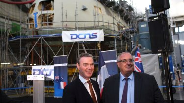 Naval Group chief executive Herve Guillou, right, at the firm's shipyards in Cherbourg, France, with Minister for Defence Industry Christopher Pyne.