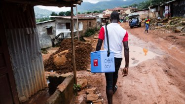 Workers conduct a cholera vaccination campaign in the Freetown neighbourhood of Kaningo.