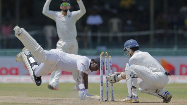 Sri Lanka's captain Angelo Mathews narrowly survives being run out against India in September.