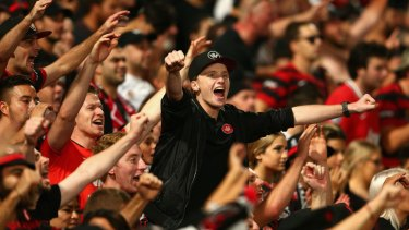 Wanderers fans celebrate a goal during the A-League Semi Final match between the Western Sydney Wanderers and the Brisbane Roar.