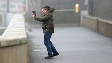A man takes a selfie at Lahinch, on the west coast of Ireland, as the remnants of Hurricane Ophelia hit.