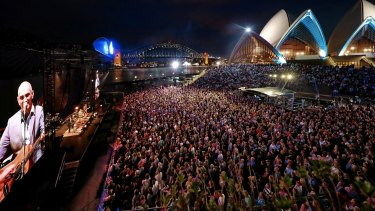 Paul Kelly plays to a rapt crowd on the Opera House forecourt.