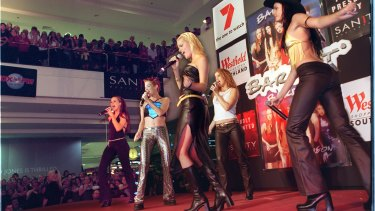 The way they were: Bardot in 2000, singing for fans at a shopping centre.