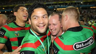 Suspended player Isaac Luke celebrates with the Rabbitohs after their grand final victory.