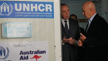 Andrew Harper gives Peter Dutton a tour of the UNHCR registration centre in Amman