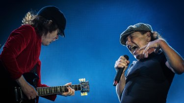 Guitarist Angus Young and Singer Brian Johnson  of AC/DC perform on stage during the legendary Australian rock band's 'Rock or Bust' World Tour at Etihad Stadium in Melbourne.
