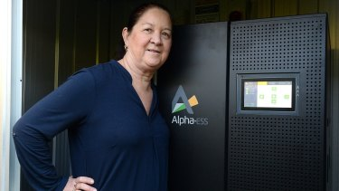 "Jane Whiltsher poses with her ""new toy"" - the battery that powers her home."