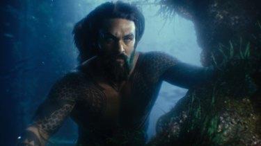 Aquaman (Jason Momoa) provides back-up muscle.