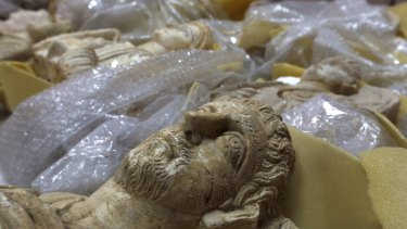 The heads of ancient figures stare at the ceiling of a store in  Damascus where thousands of priceless antiques from across war-ravaged Syria have been gathered for safekeeping.