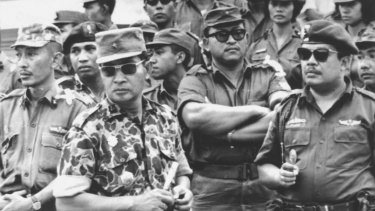 Former Indonesia president Suharto (in patterned uniform) was a major-general in 1965. Here he attends the funeral of the slain generals. He had a leading role in the anti-communist crackdown and massacres that followed.