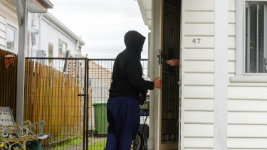 A man visits the Footscray house where Victoria's Joint Counter Terrorism Team was executing a search warrant on Tuesday.