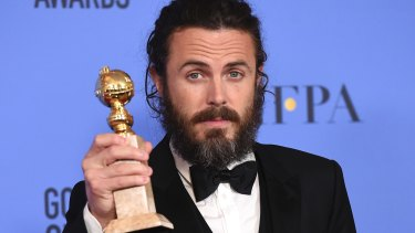 Casey Affleck poses with his Golden Globe earlier this month.