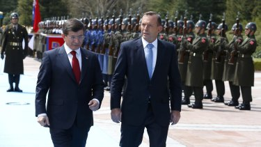 Turkish Prime Minister Ahmet Davutoglu and Australian Prime Minister Tony Abbott at the Cankaya Palace in Ankara.
