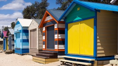 Rainbow-coloured bathing boxes at the Mornington Peninsula, which has changed dramatically in the past few decades.