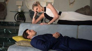 Elizabeth Debicki and Henry Cavill star in <i>The Man From U.N.C.L.E.</i>, based on the cult 1960s TV show.