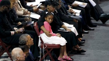 Malana Pinckney, daughter of the Reverend Clementa Pinckney, is hugged by her mother Jennifer at her father's funeral in Charleston, South Carolina on June 26.