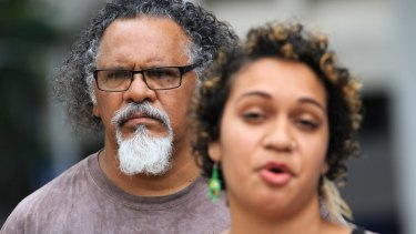 Wangan and Jagalingou traditional owner and council spokesperson Adrian Burragubba and his niece, Murrawah Johnson, speak outside the Brisbane Supreme Court after launching the challenge to the Adani Carmichael mine.