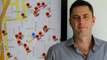 ingogo chief executive Hamish Petrie, pictured with a screenshot of the taxi hailing and payments app he created.
