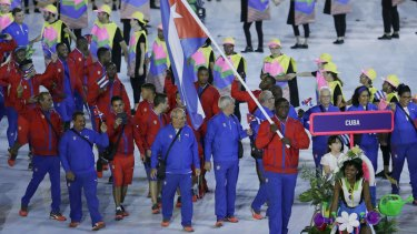 Mijain Nunez Lopez carries the flag of Cuba during the opening ceremony for the 2016 Summer Olympics in Rio de Janeiro, Brazil, Friday, Aug. 5, 2016.