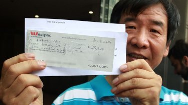 Cleaner Anping Yan leaving court, with a bounced cheque.