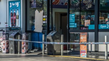 The Caltex service station where an employee was fatally stabbed remained cordoned off on Friday morning.