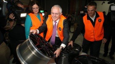 Prime Minister Malcolm Turnbull looked at a steel wheel during a visit to Carbon Revolution in Waurn Ponds.