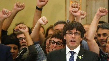 Carles Puigdemont sings the Catalan anthem inside the parliament after a vote on independence in Barcelona on Friday.