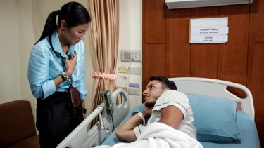 Thai Tourism Minister Kobkarn Wattanavrangkul visits Italian tourist Lorenzo Minuti, who was injured in a bomb blast, at Sanpaulo hospital in Hua Hin, Thailand.