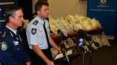 Major haul: NSW Police Commissioner Andrew Scipione and AFP Commissioner Andrew Colvin with a quarter of the drugs seized in the operation.
