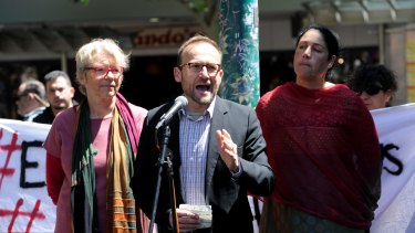 Federal Member for Melbourne Adam Bandt (centre) addresses a rally in support of asylum seekers on Manus Island.