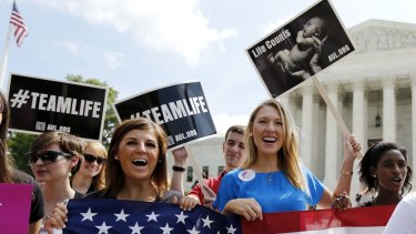 Anti-abortion protesters celebrate the US Supreme Court's ruling striking down a Massachusetts law that mandated a protective buffer zone around abortion clinics in 2014.