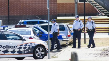 ACT Policing officers outside Lanyon High School on Tuesday following a bomb threat.