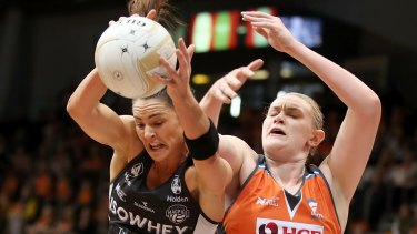 The Magpies' Sharni Layton wins the ball over Kristina Brice of the Giants.