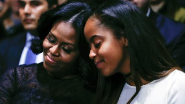 First lady Michelle Obama and daughter Malia on January 10.