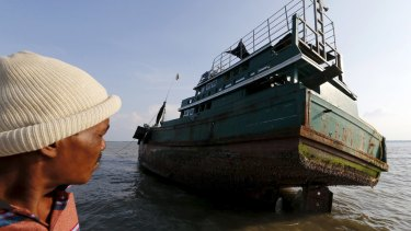 An abandoned boat which carried Rohingya and Bangladeshi migrants from Thailand is found off the coast near Indonesia's Aceh Province.