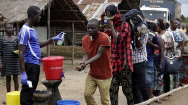 An Ebola temperature check and washing station on the edge of a quarantined area in Sierra Leone in 2015.