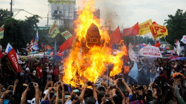 Another effigy of Filipino President Benigno Aquino III is set on fire by protesters during his last State of the Nation address.