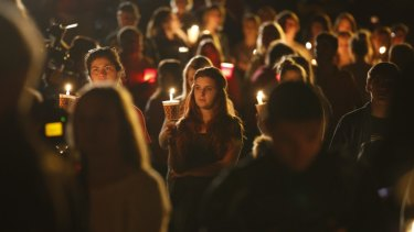 People gather for a candlelight vigil at Stewart Park in Roseburg after the shooting.