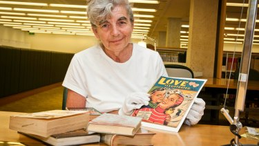 Queensland literature co-ordinator for the State Library, Joan Bruce, with some formerly banned books.
