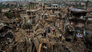 Residents foraging through their destroyed homes in Bhaktapur, Nepal, in the aftermath of last year's earthquake.