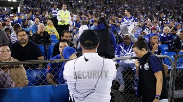 Drama: Security guards look on after a bottle was thrown from the Belmore Sports Ground crowd in April. Fairfax Media does not suggest anyone pictured was involved.
