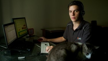 Dylan Nelson works from his South Windsor home taking customer calls for an internet service provider.